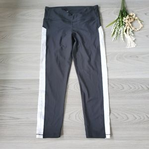 UNDER ARMOUR black leggings with white writing